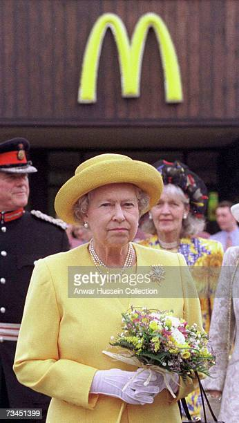 Queen Elizabeth II arrives at at McDonalad drive-thru restaurant on a visit to Cheshire Oaks Designer Outlet, July 3 1998. In Cheshire, England....