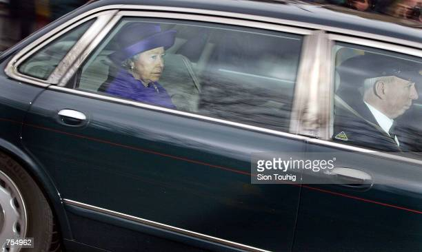 Queen Elizabeth II arrives at Kensington Palace February 11 2002 to see her sister Princess Margaret who died in London on Saturday morning The...
