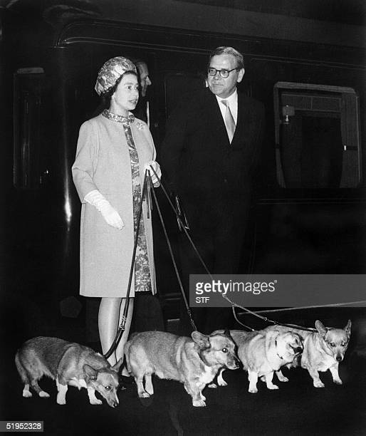 Queen Elizabeth II arrives at King's Cross railway station in London 15 October 1969 with her four dogs of Corgis breed after holidays in Balmoral...