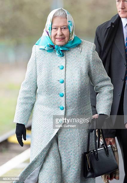 Queen Elizabeth II arrives at King's Lynn Station to begin her Christmas holiday at Sandringham on December 18 2014 in King's Lynn England