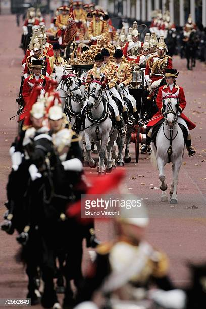 Queen Elizabeth II arrives back at Buckingham Palace after deliverying a speech at the state opening of Parliament on November 15 2006 in London...