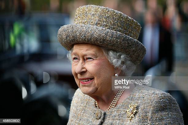 Queen Elizabeth II arrives before the Opening of the Flanders' Fields Memorial Garden at Wellington Barracks on November 6 2014 in London England