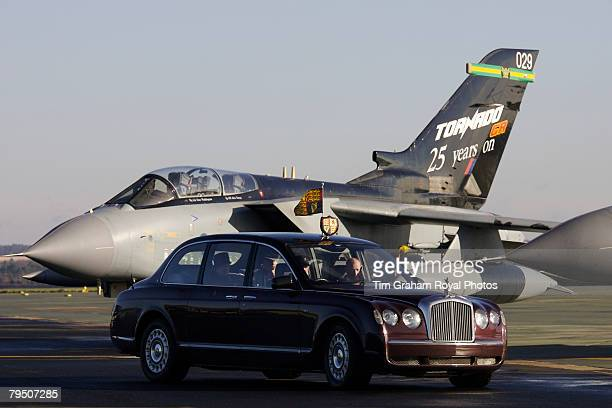 Queen Elizabeth II arrives by Rolls Royce passing a Tornado jet plane for an official visit to RAF Marham on February 4 2008 in Norfolk England The...