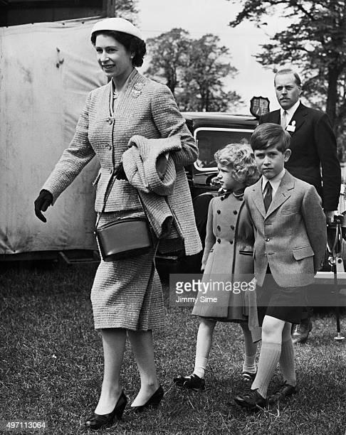 Queen Elizabeth II arrives for the final day of the Windsor Horse Show with her children Prince Charles and Princess Anne England 12th May 1956