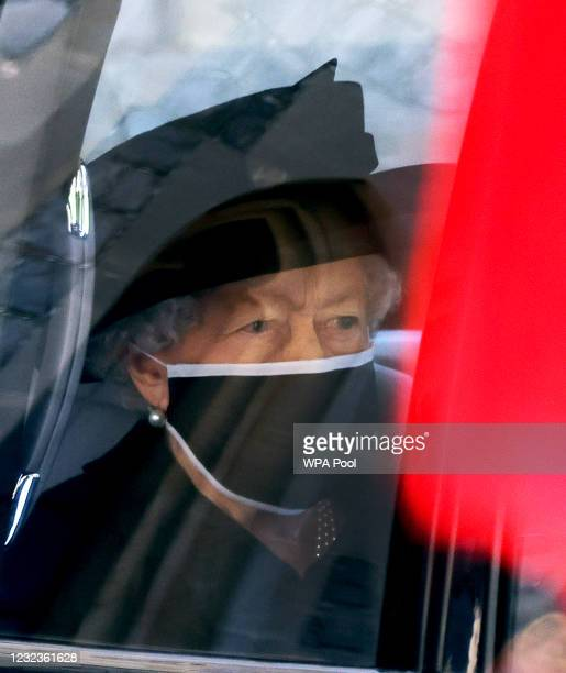 Queen Elizabeth II arrives for the funeral of Britain's Prince Philip, Duke of Edinburgh at St George's Chapel at Windsor Castle on April 17, 2021 in...