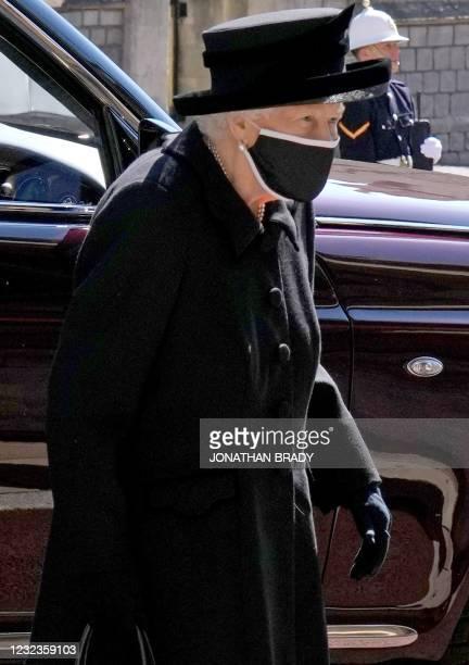 Queen Elizabeth II arrives for the funeral service of Britain's Prince Philip, Duke of Edinburgh inside St George's Chapel in Windsor Castle in...