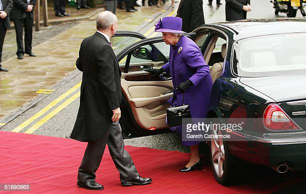 Queen Elizabeth II arrives for the wedding of Ed Van Cutsem and Lady Tamara Grosvenor at Chester Cathedral on November 6 2004 in Chester England Lady...