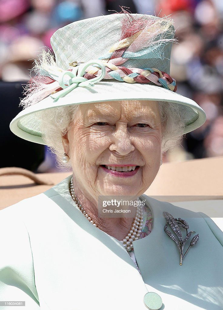Queen Elizabeth II arrives in a horse drawn carriage for the opening day of Royal Ascot at Ascot Racecourse on June 14, 2011 in Ascot, United Kingdom.