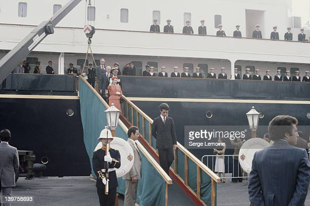 Queen Elizabeth II arrives in Algeria for a state visit and disembarks from the royal yacht 'Britannia' accompanied by her husband Prince Philip and...