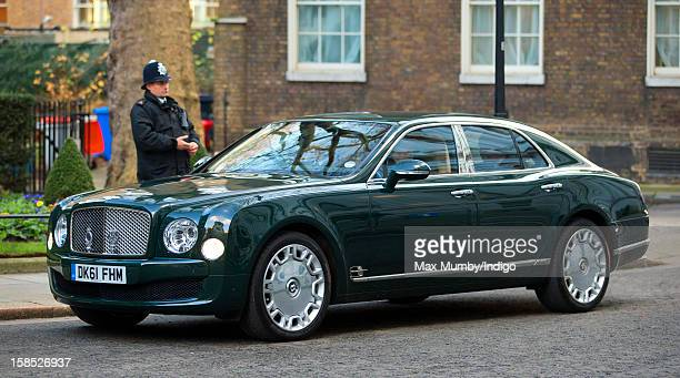 Queen Elizabeth II arrives in Downing Street in her Bentley car where she is attending the Government's weekly Cabinet meeting on December 18 2012 in...