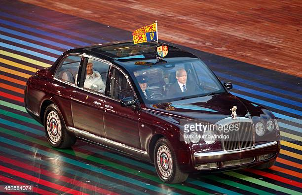 Queen Elizabeth II arrives in her Bentley Car to attend the Opening Ceremony for the Glasgow 2014 Commonwealth Games at Celtic Park on July 23 2014...