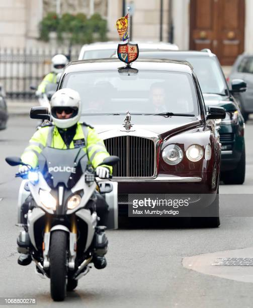 Queen Elizabeth II arrives in her chauffeur driven Bentley State Limousine flanked by Metropolitan Police Motorcycle outriders of the Special Escort...