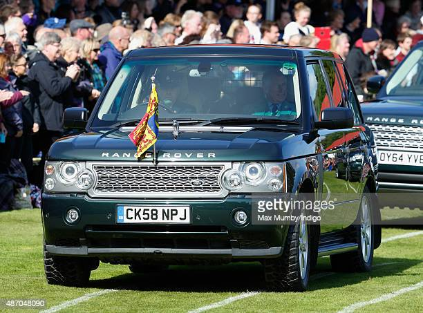Queen Elizabeth II arrives in her Range Rover car accompanied by Prince Philip Duke of Edinburgh and Prince Charles Prince of Wales to attend the...