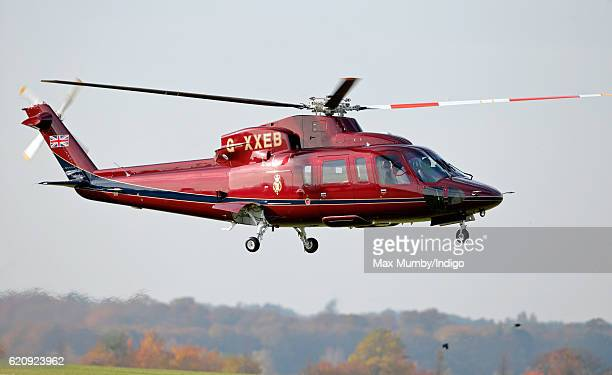 Queen Elizabeth II arrives in her Sikorsky Helicopter to unveil a statue depicting herself alongside a mare and it's foal in 1977 on November 3 2016...