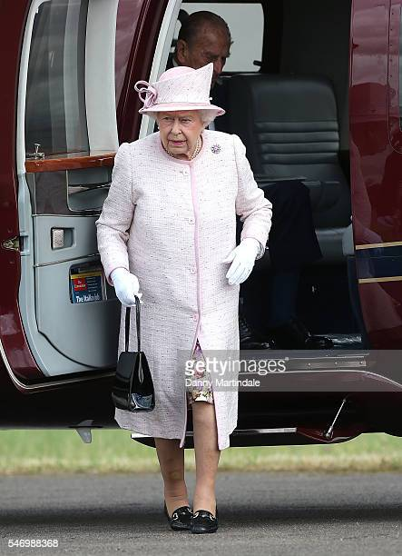 Queen Elizabeth II arrives in the royal helicopter to open the new East Anglian Air Ambulance Base at Cambridge Airport on July 13 2016 in Cambridge...