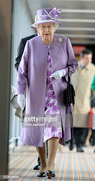 Queen Elizabeth II arrives through a terminal airbridge from the Royal Plane at the new James Armstrong Richardson International airport on July 3...