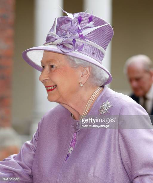 Queen Elizabeth II arrives to attend Evensong at the Chapel Royal Hampton Court Palace to celebrate the Centenary of the founding of the Companions...