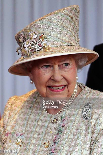 Queen Elizabeth II arrives to greet The President of the United Arab Emirates His Highness Sheikh Khalifa bin Zayed Al Nahyan on the Royal Dais on...