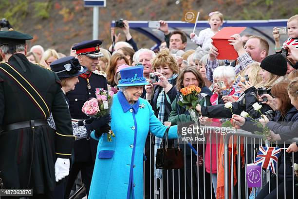 Queen Elizabeth II arrives to greets wellwishers before she unveils a commemorative plaque at Newtongrange railway station on board the steam...