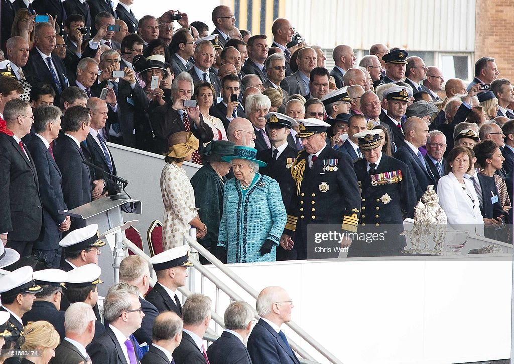 Queen Elizabeth II arrives to officially name the Royal Navy's new aircraft carrier HMS Queen Elizabeth on July 4, 2014 in Rosyth, Scotland. HMS Queen Elizabeth is the largest warship ever built in the UK weighing 65,000-tonnes, six shipyards around the UK have been involved in building various parts of the carrier. The ship is capable of carrying up to forty aircraft, is scheduled to be launched later this summer, and to commission in early 2017, with full operational capability from 2020.