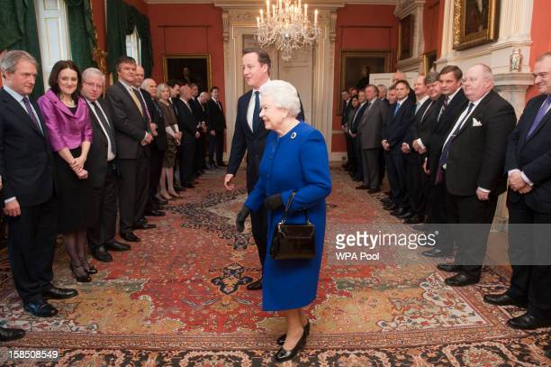 Queen Elizabeth II arrives with British Prime Minister David Cameron to meet members of the cabinet at Number 10 Downing Street as she attends the...