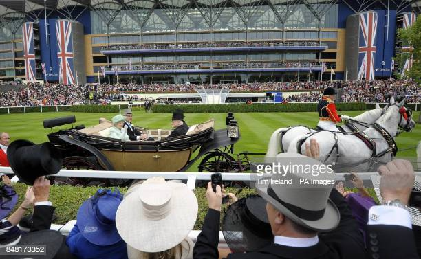 Queen Elizabeth II arrives with the Duke of Edinburgh for Ladies Day during day three of the 2012 Royal Ascot meeting at Ascot Racecourse, Berkshire.