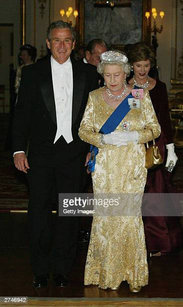 HRH Queen Elizabeth II arrives with US President George W Bush in the music room at Buckingham Palace on November 19 2003 in London The Queen was...