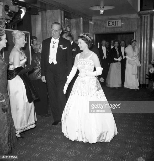 Queen Elizabeth II arriving at the Odeon, Leicester Square, London for the world charity premiere of the film 'Lawrence of Arabia'.