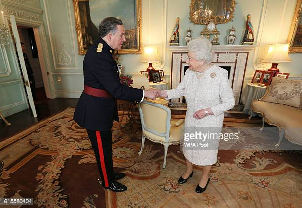 Queen Elizabeth II as Captain General Royal Regiment of Canadian Artillery receives Brigadier James Selbie Colonel Commandant Royal Regiment of...