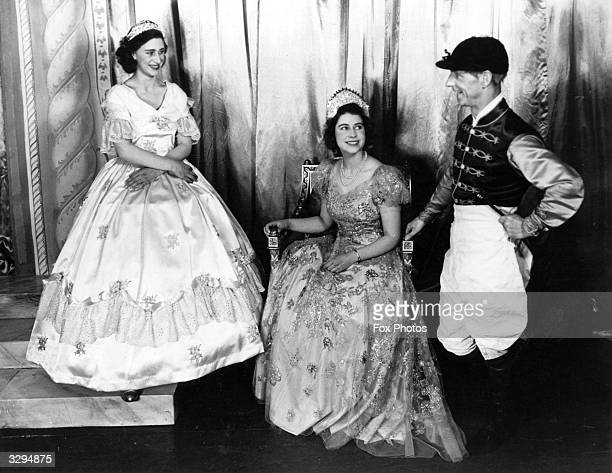 Queen Elizabeth II as Princess Elizabeth, and her sister Princess Margaret Rose in their costumes for a performance of 'Old Mother Red Riding Boots'....