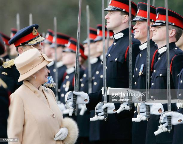 Queen Elizabeth II as proud grandmother smiles at Prince Harry as she inspects soldiers at their passingout Sovereign's Parade at Sandhurst Military...