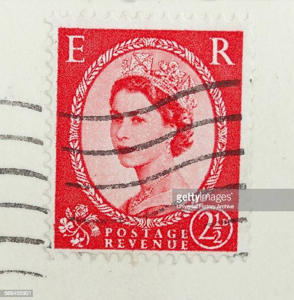 Queen Elizabeth II as she appeared on an English postage stamp circa 1958