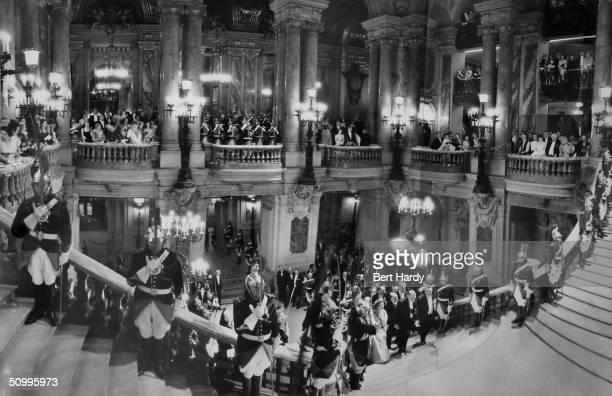 Queen Elizabeth II ascending the Grand Staircase at the Opera in Paris during a state visit to the French capital 8th April 1957 The image is a...