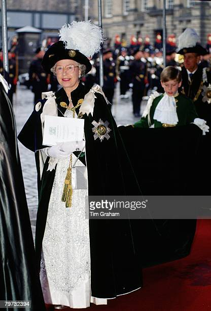 Queen Elizabeth II assisted by a Page of Honour arrives at St Giles Cathedral for the Order of the Thistle ceremony