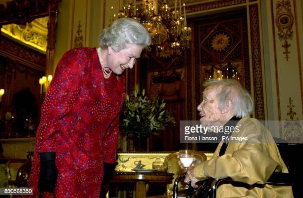 Queen Elizabeth II at a reception at Buckingham Palace in London for the British Book World chatting with Frances Partridge sole surviving member of...