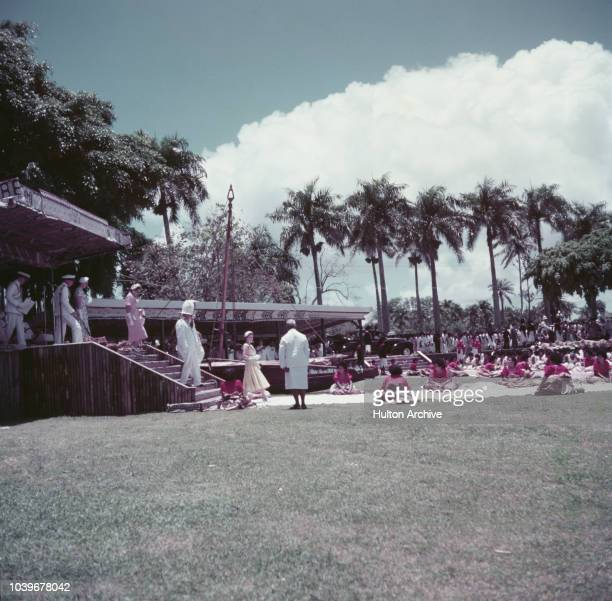 Queen Elizabeth II at a welcoming ceremony in Albert Park Suva Fiji during her coronation world tour December 1953 Behind the queen is the Governor...