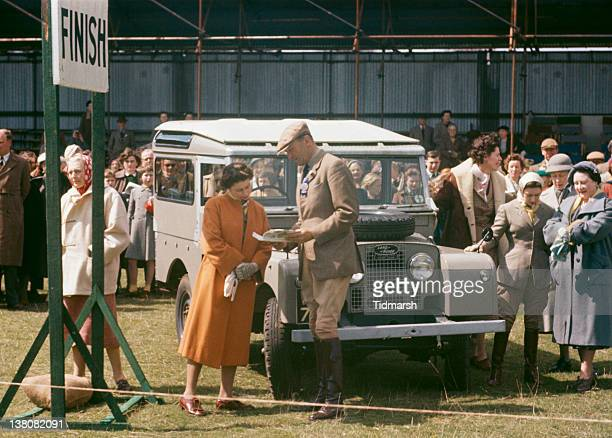 Queen Elizabeth II at Badminton House, Gloucestershire, for the Badminton Horse Trials, April 1956. On the right are Princess Margaret and the Queen...