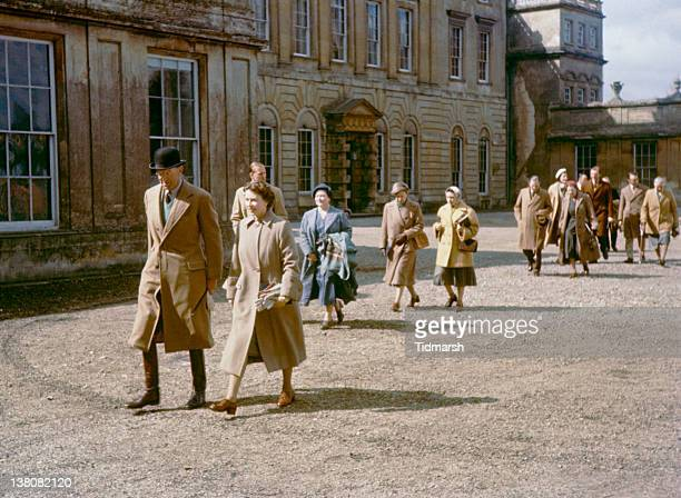 Queen Elizabeth II at Badminton House Gloucestershire for the Badminton Horse Trials April 1956 Behind her are Prince Philip Duke of Edinburgh and...