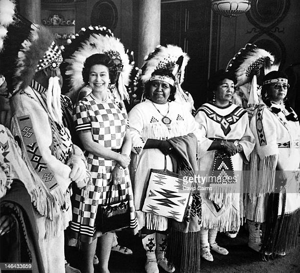 Queen Elizabeth II at Buckingham Palace with a group of indigenous Canadians during their visit to the UK in 1973