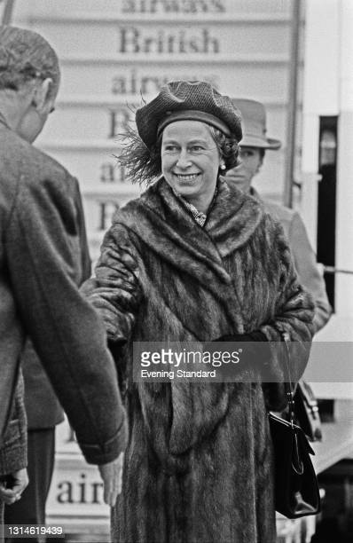 Queen Elizabeth II at Heathrow Airport in London, where she is meeting her daughter Princess Anne and Captain Mark Phillips after their flight from...