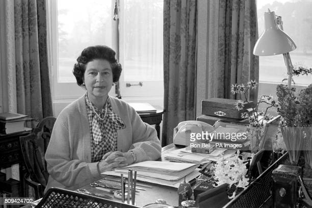Queen Elizabeth II at her desk in the study of Sandringham House her Norfolk home where she marked her 30th anniversary of her accession to the throne