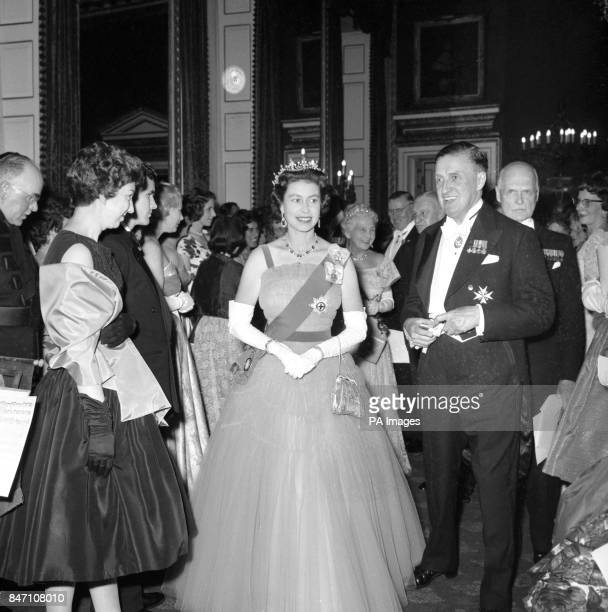Queen Elizabeth II at St James's Palace attending the Victoria League diamond jubilee reception Seen with the Queen is the chairman of the reception...