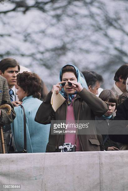Queen Elizabeth II at the Badminton Horse Trials, circa 1980. Prince Andrew is visible to the left.