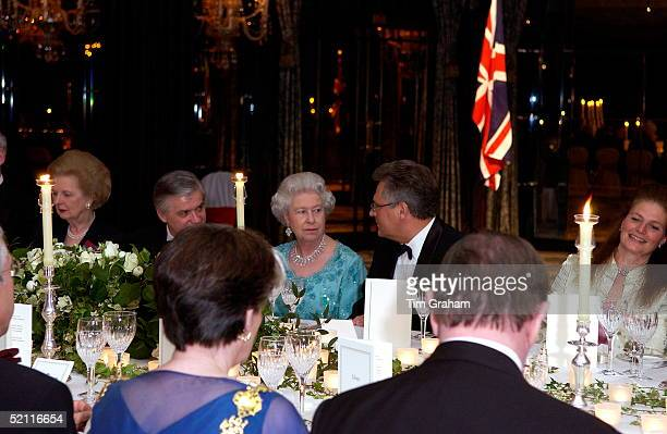 Queen Elizabeth II At The Top Table With The President Of Poland Aleksander Kwasniewski At The Banquet At The Dorchester Hotel