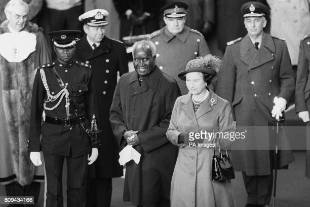 Queen Elizabeth II at Victoria Station greeting hatless President Kenneth Kaunda of Zambia at the start of his four day State Visit