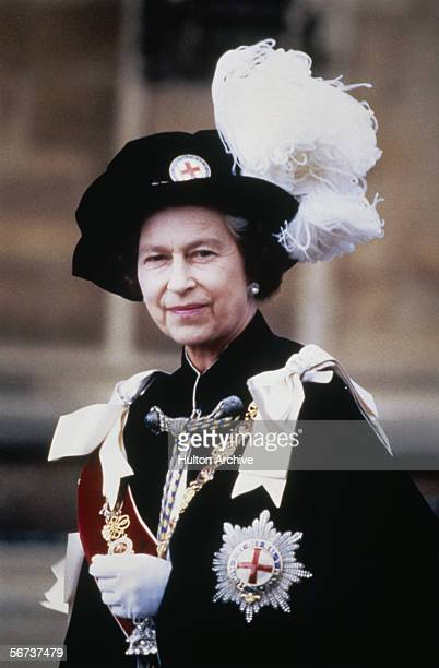 Queen Elizabeth II at Windsor in Berkshire for the ceremony of the Order of the Garter 1983 She is wearing the star insignia bearing the motto of the...