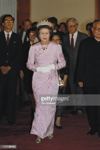 Queen Elizabeth II attending a banquet held in the Hall Of The People Beijing while on an official state visit to China 13 October 1986 The dress...