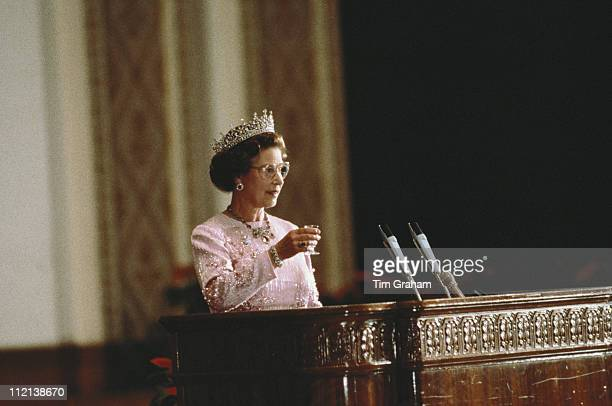 Queen Elizabeth II attending a banquet held in the Hall Of The People Beijing whille on an official state visit to China 13 October 1986 The dress...