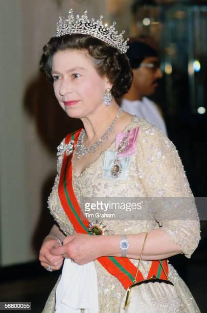 Queen Elizabeth II attends a banquet at Claridges in London.