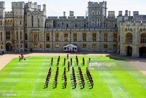 Queen Elizabeth II attends a ceremony to mark her official birthday at Windsor Castle on June 13, 2020 in Windsor, England. The Queen celebrates her...